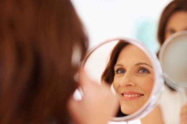Woman looking in mirror