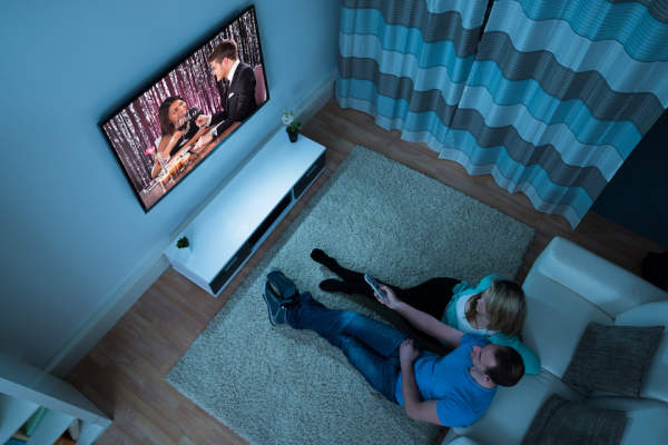 couple watching tv before bed in living room