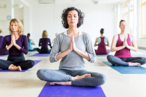Yoga class for stress reduction and exercise.