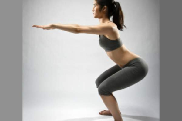 Woman demonstrating squats