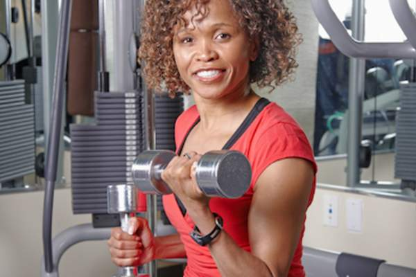 Woman performing bicep curls