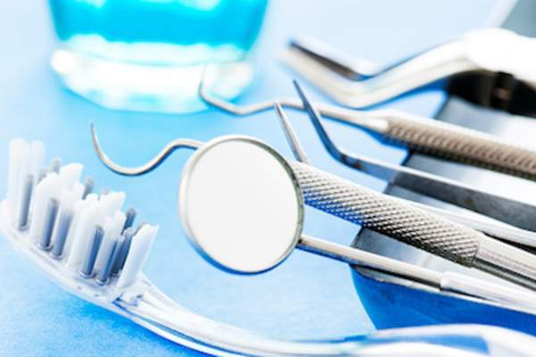 toothbrush and dental tools, dentist can diagnose and treat diseases causing bad breath.