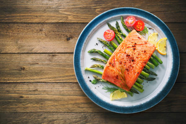 Grilled salmon over asparagus.