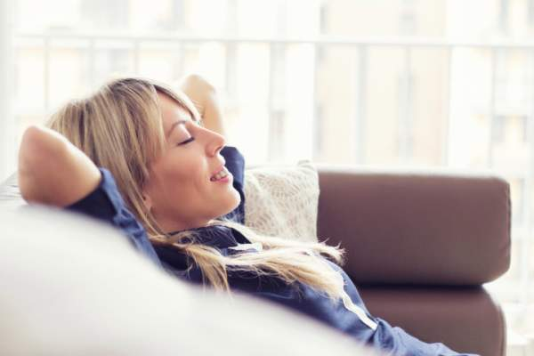Woman relaxing with eyes closed.