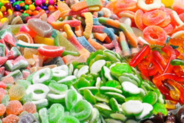 Pile of loose, mixed, sugar-coated candies and movie snacks.