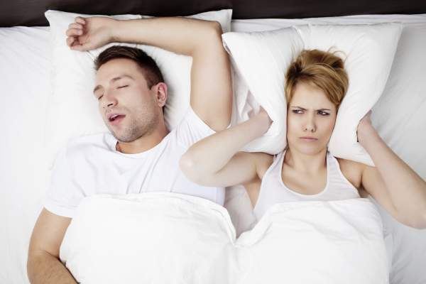 Snoring man keeping partner awake.
