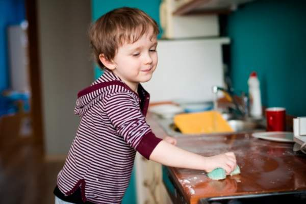 Young boy helping with household chores.