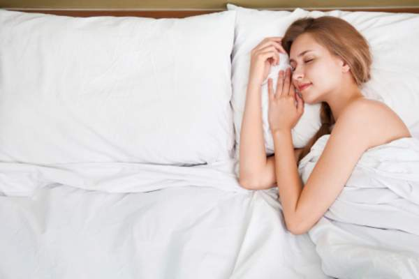 Woman sleeping in bed comfortably