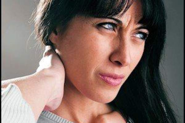 Woman with neck pain.