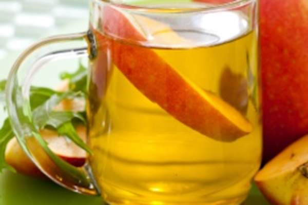 Apple cider vinegar in glass.