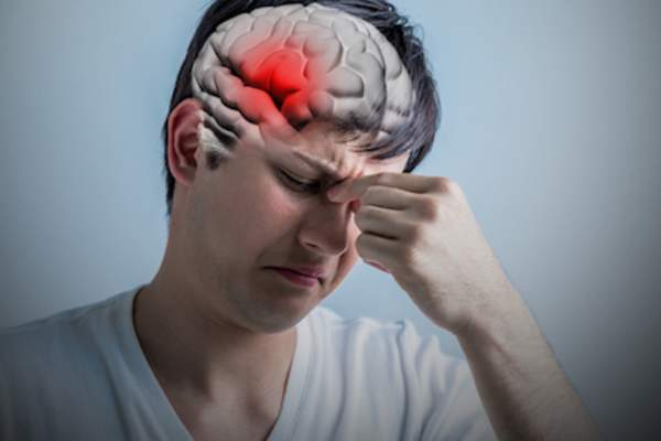 Migraine stroke concept highlighted brain.