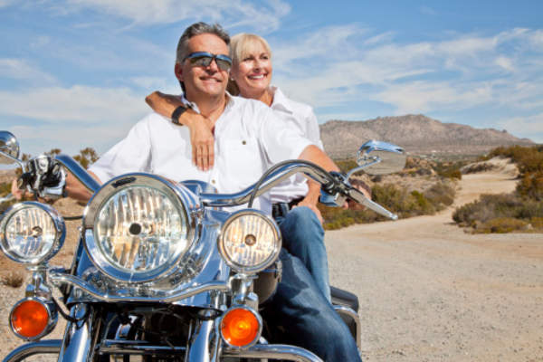 Couple on motorcycle.
