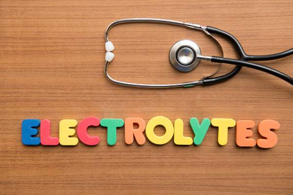 "Stethoscope and letter magnets spelling ""electrolytes"""