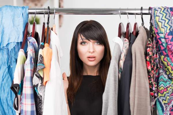 Woman experiences irritation from fragrance on her clothes hanging in closet.