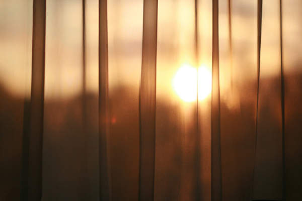 Curtain drawn with sun still up