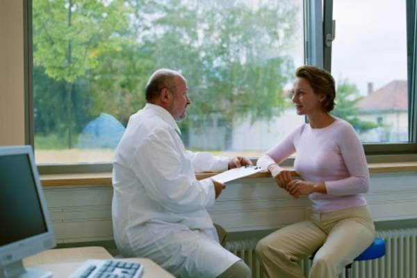woman talking to doctor image