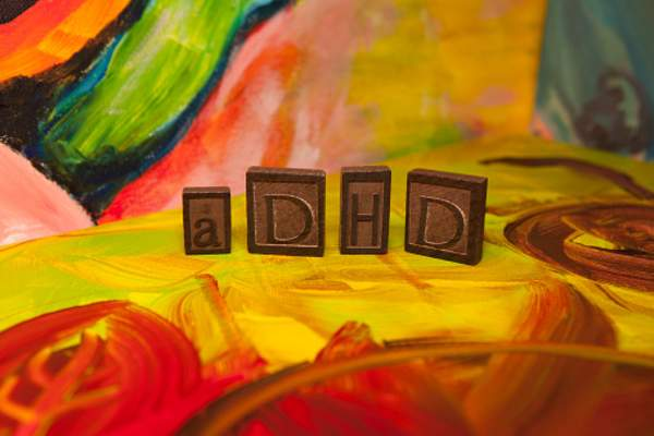 ADHD spelled out in wood block letters.