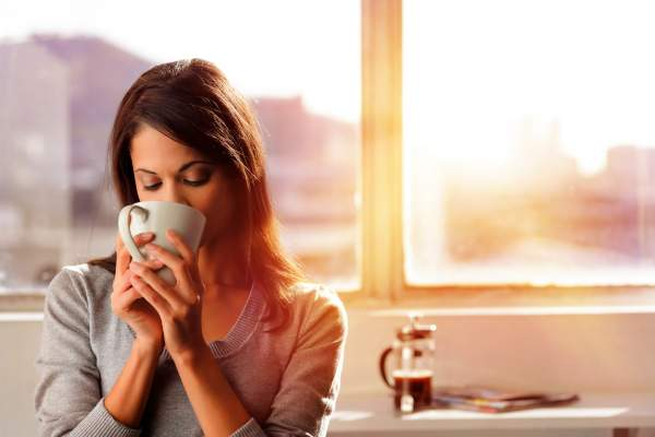 Young woman drinking coffee in the morning.