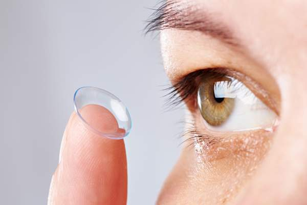 Woman with contact lens inside out.