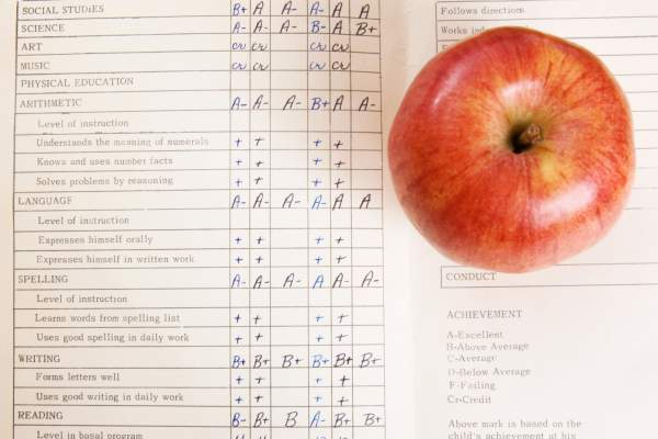 School report card and apple.