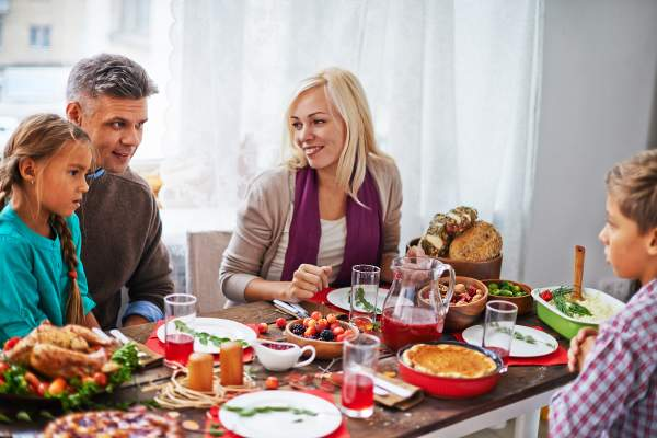 Man and woman talking at thanksgiving dinner.