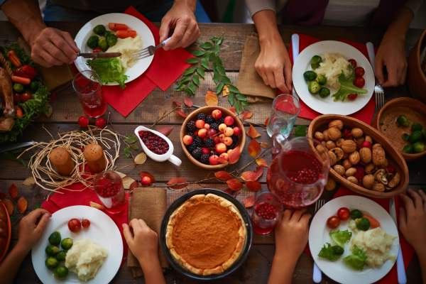 Choosing from a wide selection of Thanksgiving foods.