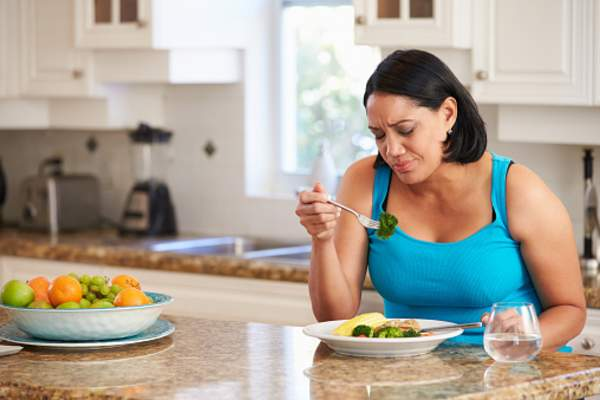 Woman eating healthy meal.