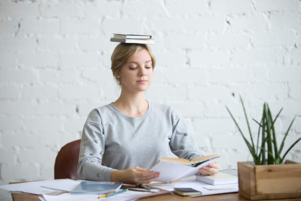 woman balancing book on her head