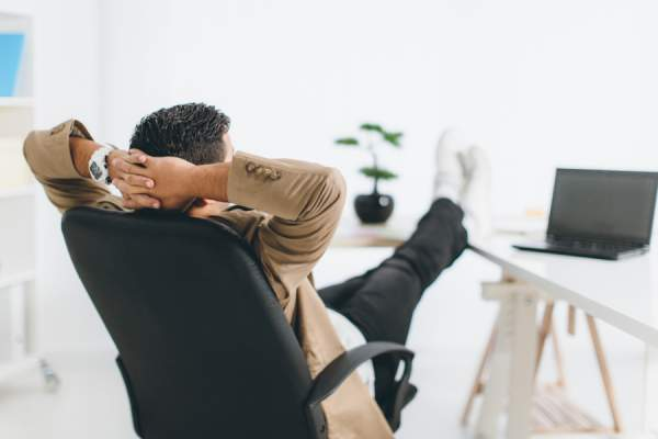 Young man relaxing in office