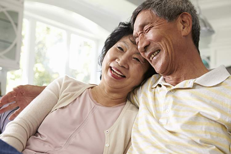 Senior couple smiling at home together