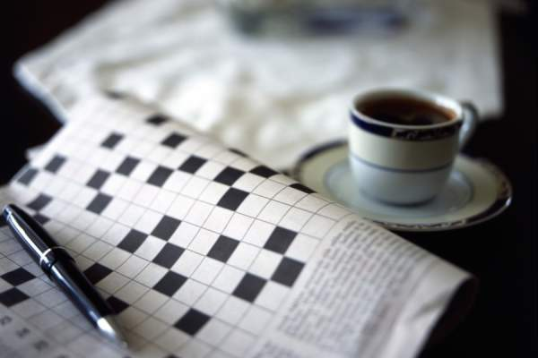 Crossword puzzle and coffee