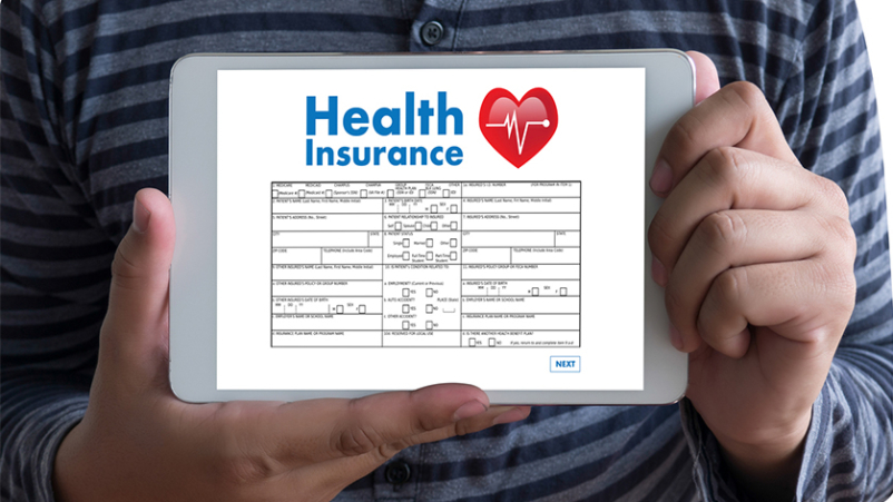 Young man holding tablet with health insurance information.