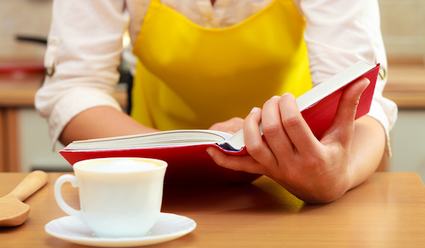 Reading a cookbook in kitchen