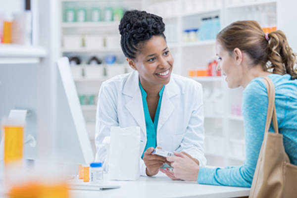 Pharmacist explaining something to a customer
