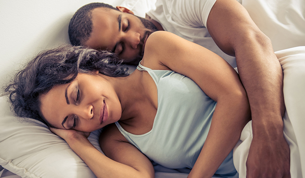Young couple sleeping in bed image.