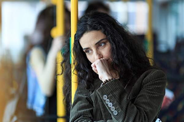 Depressed woman on a bus.