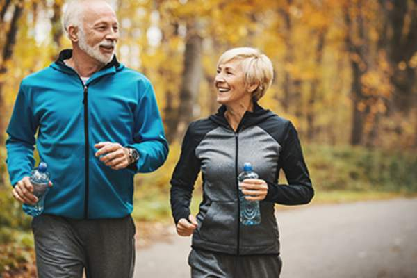 Senior couple jogging together.