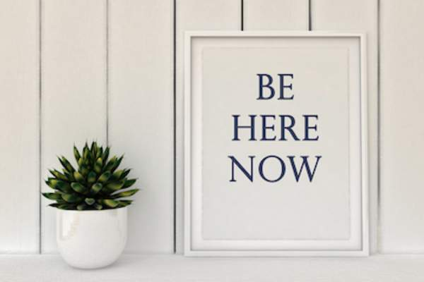 Be here now mindfulness sign.