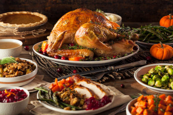 Holiday meal with turkey and side dishes.