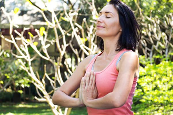 Woman using deep breathing techniques.