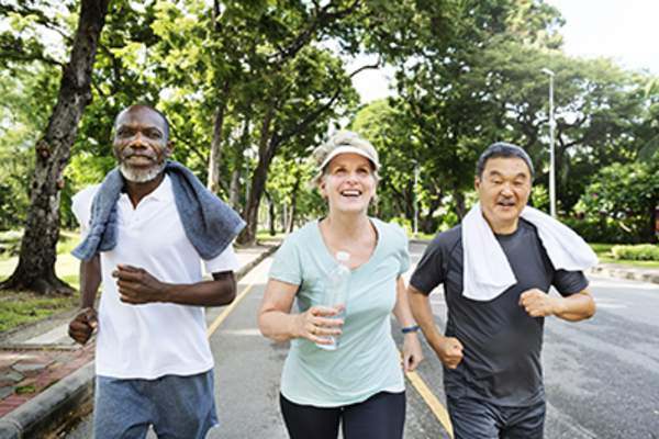 Mature adults jogging together.