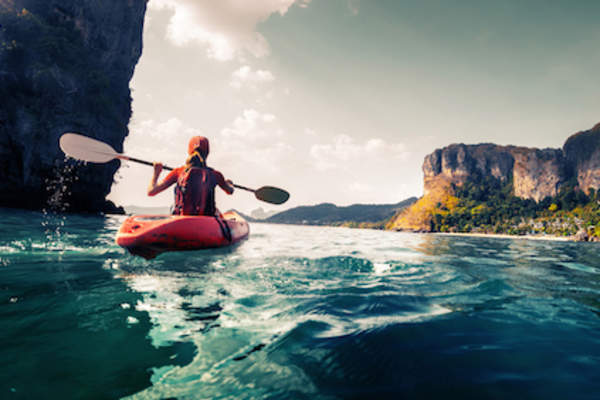 Woman kayaking.