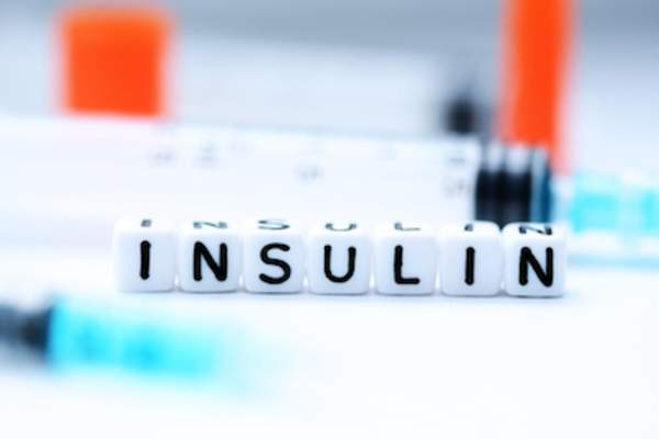 Insulin spelled out with little plastic letter blocks.