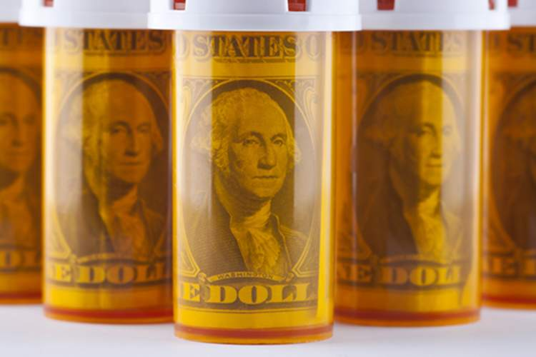 Dollar bills in prescription bottles.