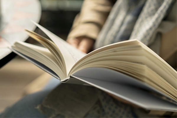 Close-up of woman reading book.