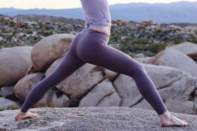 Woman with stomach exposed doing yoga