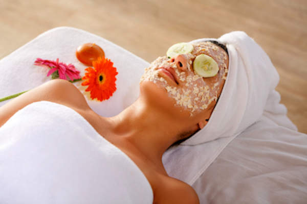 Oatmeal face scrub on womans face.