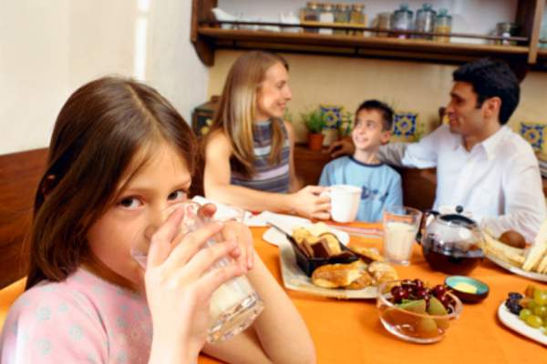 family eating breakfast image