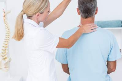 A chiropractor aligns a patient's spine.