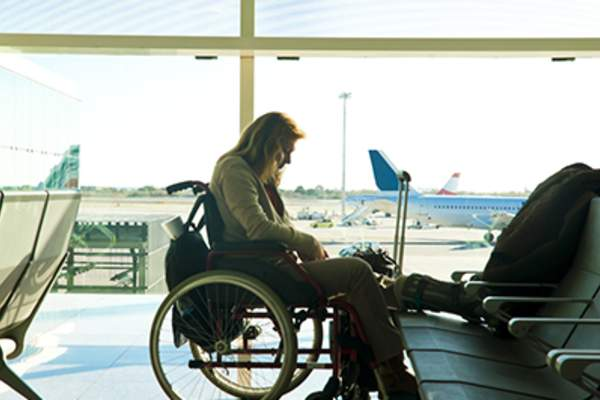 Disabled woman sitting in wheelchair at the airport